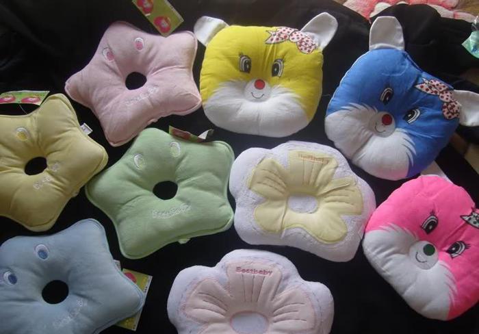 Виды подушек-бабочек для новорожденных